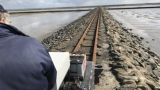 Narrow-gage railway with electric drive from Linde eMotion traveling on the island